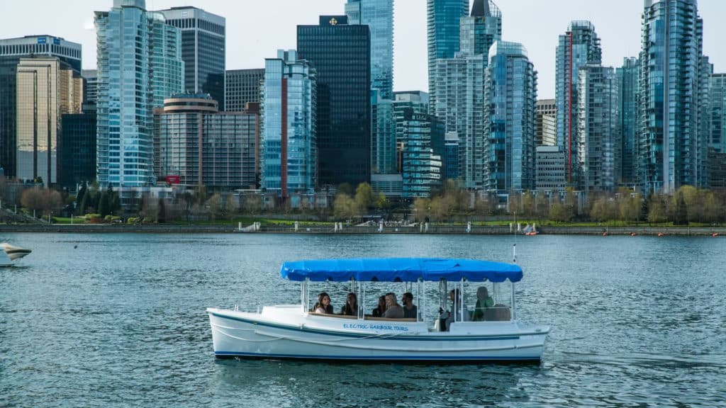 Electric Harbour Tours with city in background